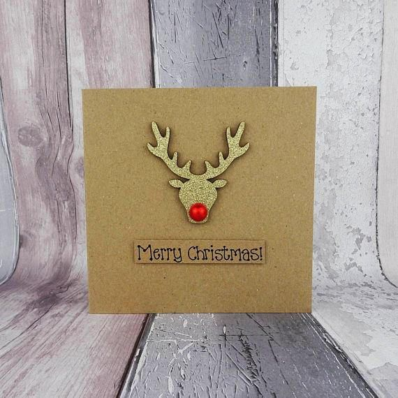 This special handmade Christmas card features a gold glittered wooden reindeer embellishment and shiny red nose - its Rudolph the reindeer! The sentiment on this handmade Christmas card is added to the card with 3D foam and reads: Merry Christmas! Alternatively you can choose any of the