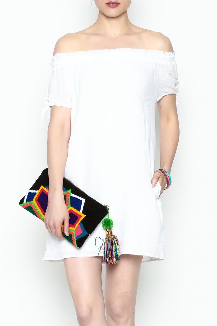 This white tunic dress is soft, with knots on the short sleeves and buttons down the back. It has an under layer of a tee shirt, a mod feel and pairs well with an espadrille, wedge or flat. White Tunic Dress by Generation Love . Clothing - Dresses - Mini Clothing - Dresses - Off The Shoulder New York City