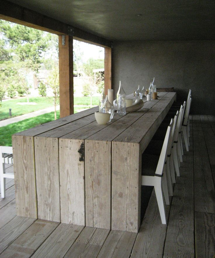 Scaffolding board table, like the way it meets the floor. It will be a great extension to the decking project - dining table