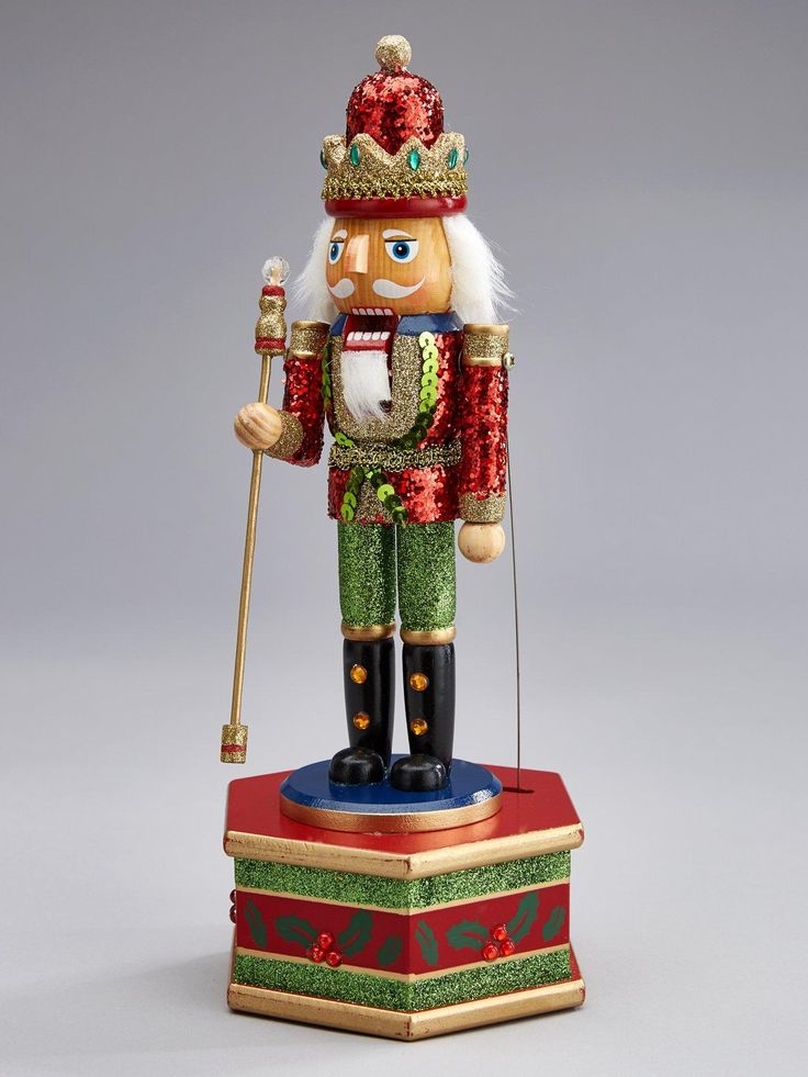 Gisela Graham Gisela Nutcracker Music Box Christmas Decoration - 32 cm If you love the traditional Christmas story of the Nutcracker Suite then you can watch it come to life whenever you like with this Nutcracker music box by Gisela Graham. Standing 32 cm tall, he's proudly decked in a sparkly sequined suit that will shimmer in the lights of your festive display. For added fun he'll not only play the tuneThe Nutcracker Suitebut will also move his arms in time with the music.Size: Heig...