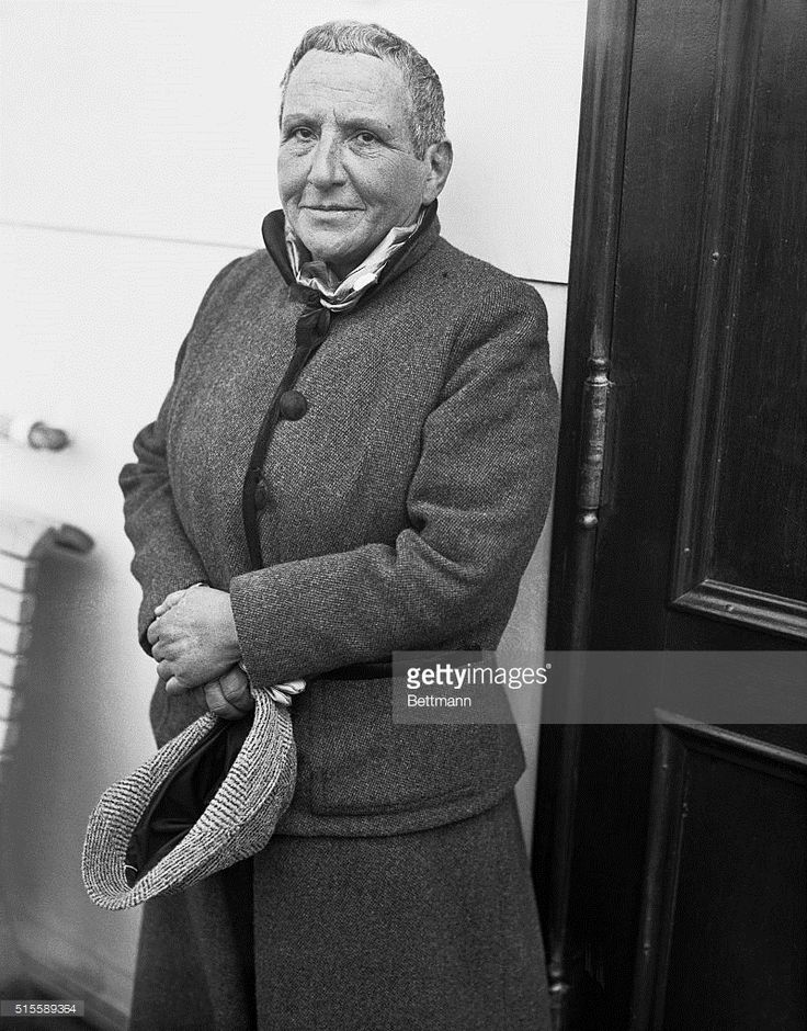Gertrude Stein, famous American poet and writer now living in Paris, whose opera, Four Saints in Three Acts, was a sensation of last season, pictured on her arrival in New York, Oct. 24, on the liner Champlain. She is planning a series of lectures in the principal universities of the United States.