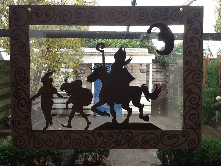 """""""Open schilderij"""" met silhouet van Sint en Piet"""