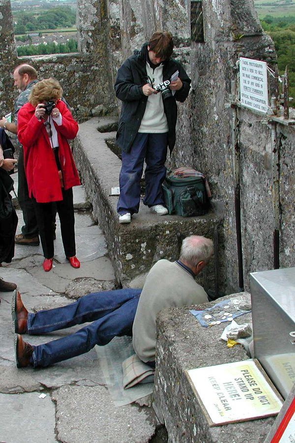 The Best and Worst of Europe By Rick Steves - (Tourists at Blarney Stone, Blarney Castle, Ireland)