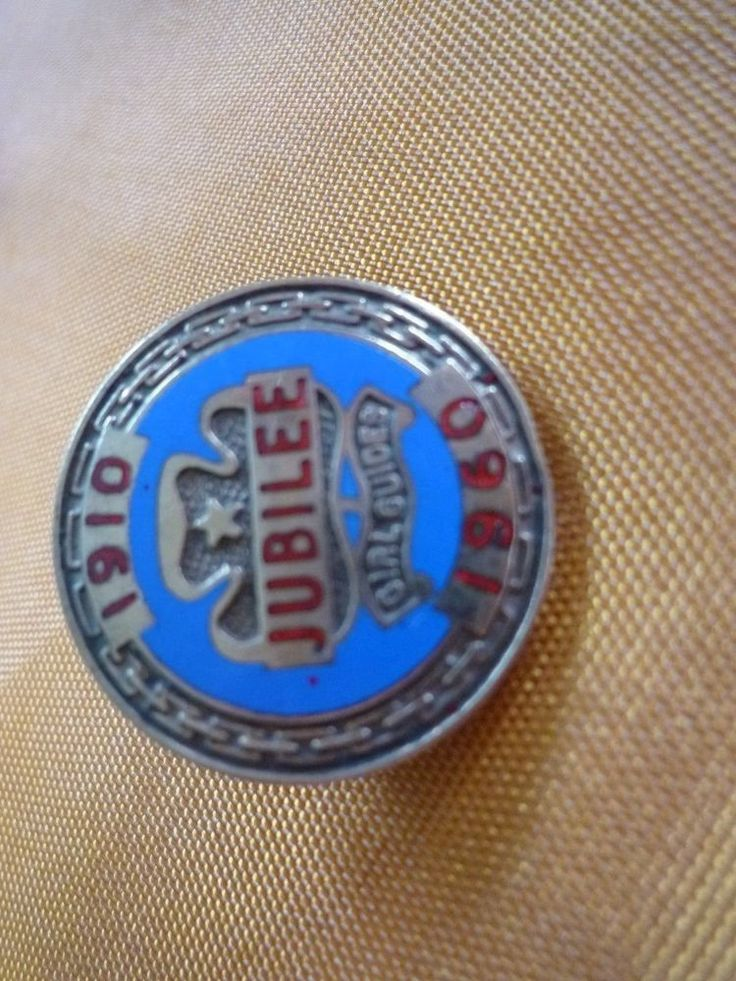 RARE ENAMEL AND METAL GIRL GUIDE JUBILEE 1910-1960 BADGE. by COLLINS LONDON.
