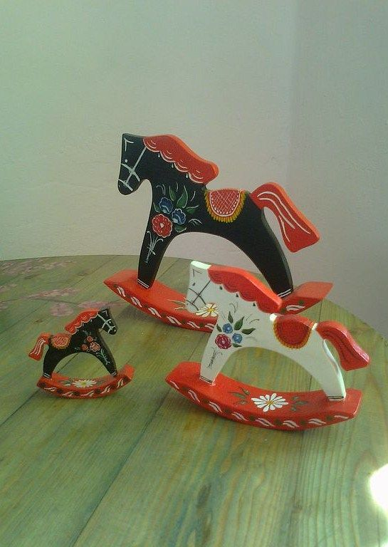 Wooden horses with folk Gorodets painting are traditional Russian toys. folk art