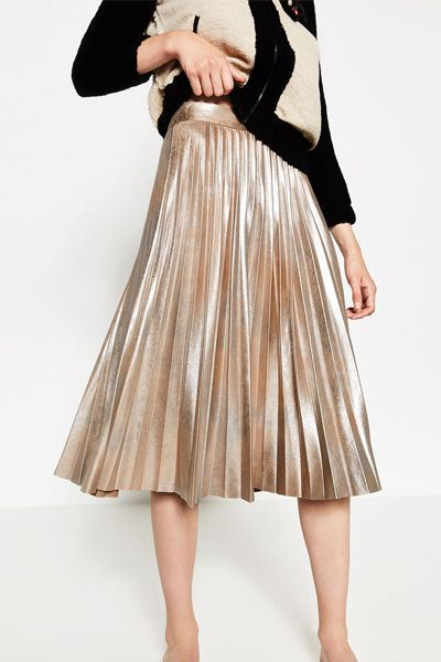 If you're not partial to a sequin, but still want to embrace the sparkle this party season, opt for lamé, the cooler way to wear the metallic trend.  To style this bold look, opt for a chromatic silver pleated midi and team with a chunky black knit and boots for work appropriate style; or, go all out in brassy gold trousers from Topshop (the bow detail adds a feminine twist) or Etro, whose flared-style will add a retro edge to your Christmas dressing.