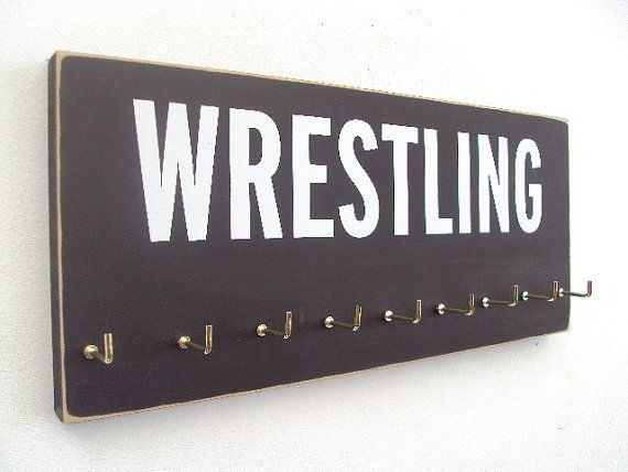 Wrestling medals holder by runningonthewall on Etsy, $28.99