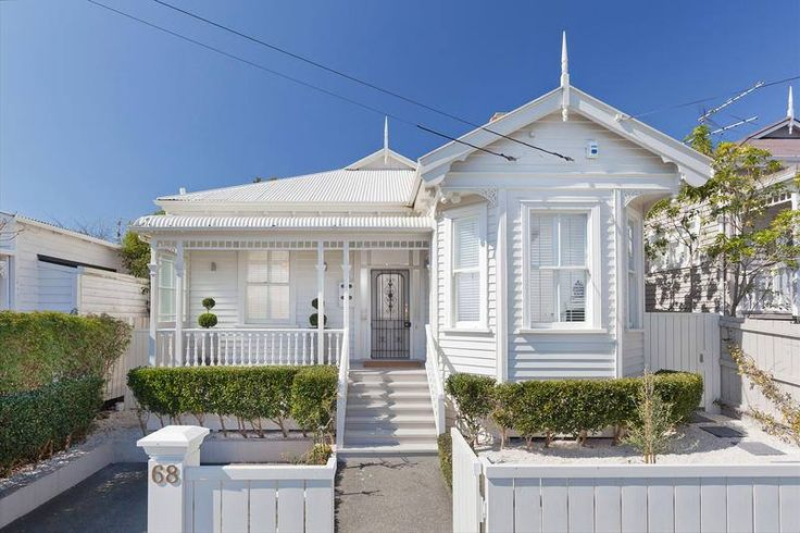 all white, auckland villa. nb. fence