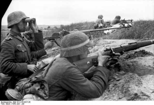 German infantry manning a trench on the Eastern Front, 1942, with anti tank rifle centre.