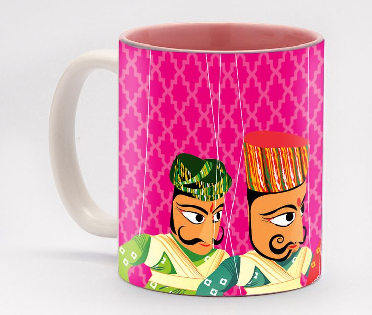 Band Baja barati - Pink Mug One of our most popular designs, these playful puppets will ensure that your day starts off with a lot of drama – the fun kind of drama, that is! Inspired by traditional Rajasthani string puppets, these expressive puppets can bring a smile to anyone's face, and the blue background really makes the puppets pop. You can fill this mug with stationery supplies and use it to instantly brighten up a dull workspace.