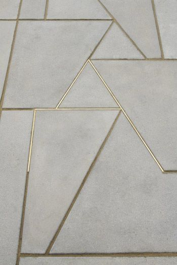 Concrete inlaid with brass
