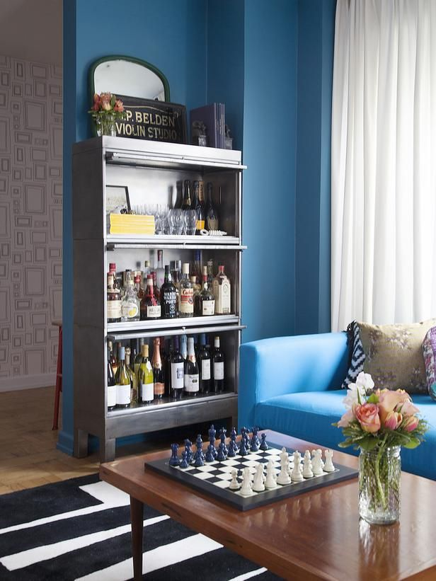 A garage-door style file cabinet is converted into a well-stocked bar.