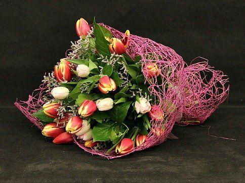 Unique mesh wrapped around tulips.