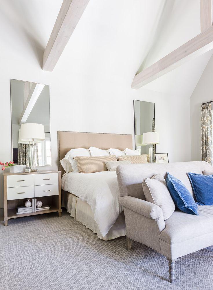 Neutral master bedroom with bright blue accent pillows. Build and Design // Austin Bean Design Studio Photography // Alyssa Rosenheck Featured // Elle Decor