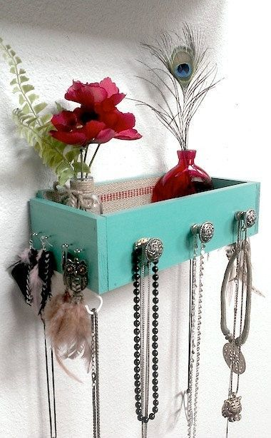 DIY painted drawer for a shelf. Perhaps drill cord holes in the bottom and plug-in cell phones. Hang keys from the knobs.