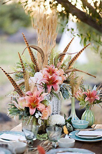 http://www.apartmenttherapy.com/bohemian-table-inspiration-feather-centerpieces-180657