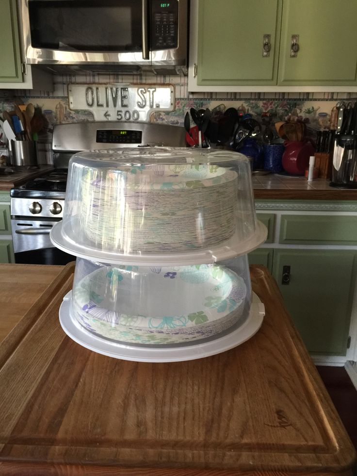 """Dollar Tree cake covers to store paper plates. I have one for my 10"""" plates and one for the 9"""" plates. Keeps them clean when stored in the garage. No more wrestling with that huge plastic bag they come in from Sam's or Costco when I need to replenish my kitchen supply."""