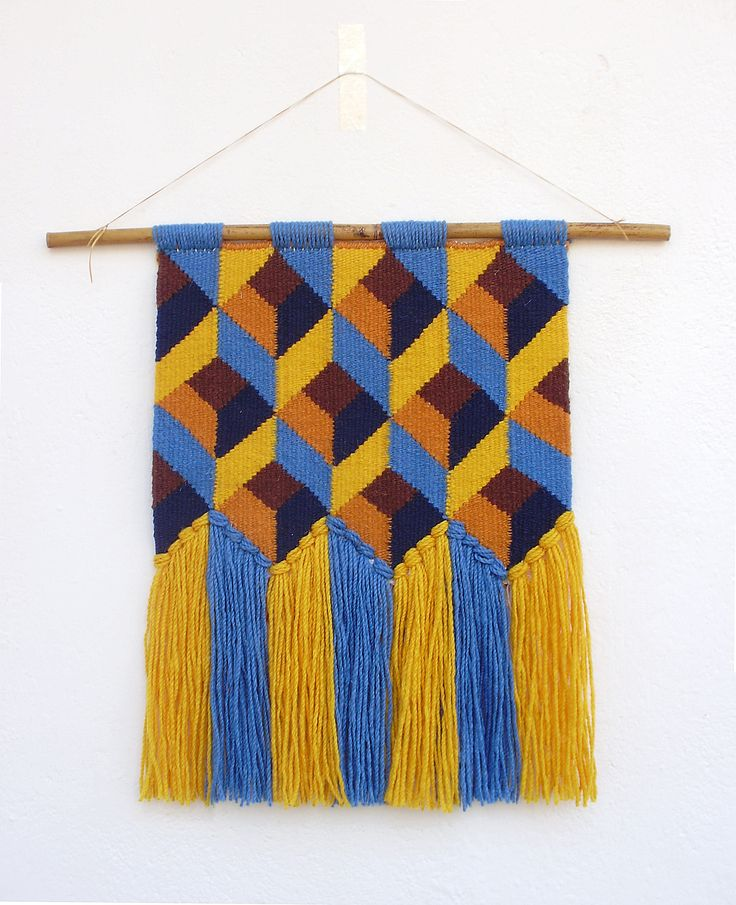 Beautiful hand woven wall hanging with geometric design. I love this tapestry and I feel really proud of it. The colours match perfectly and the details are lovely. Theres also something swedish about it : ) It belongs to my series of tapestries with a retro inspired design. Ive used yellow, soft orange, blue, marine blue and brown wool yarns. It is entirely made of natural fibers. Nice quality wool for the weft and cotton yarn for the warp. It hungs from a bamboo stick. The piece measure… – Lauren Crabtree