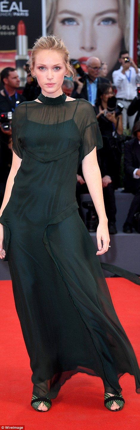 Glamour:Also putting in an appearance in a floor-length semi sheer black…