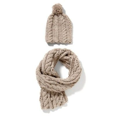 The knitted cap and the shawl finished with a decorative design. Ultra soft and warm