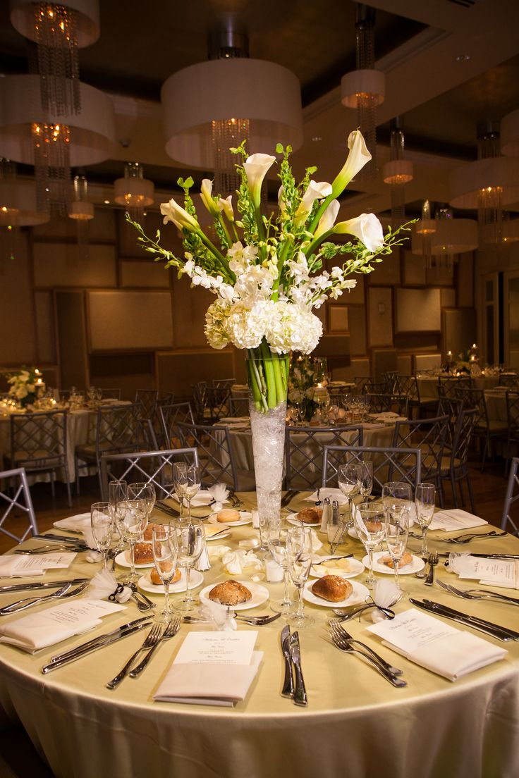 Pilsner vase arranged with white hydrangea