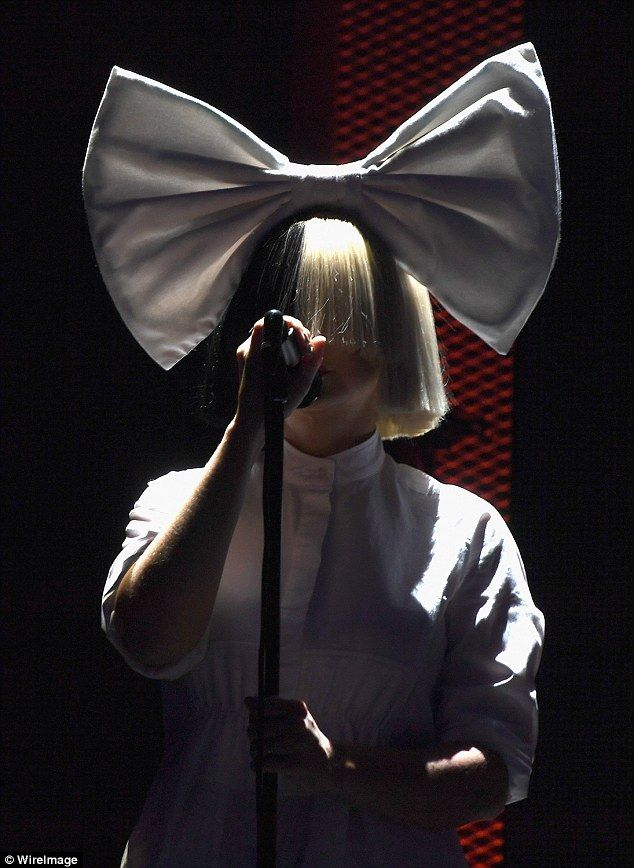 Star! Australian singer Sia performed with her iconic wig and a gigantic white bow on top of her head onstage at the 2016 iHeartRadio Music Festival on Friday night alongside dancers