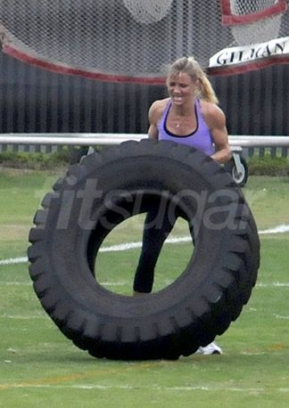 Those incredibly toned arms don't come easy. Cameron recently took to tossing tires to keep her definition.