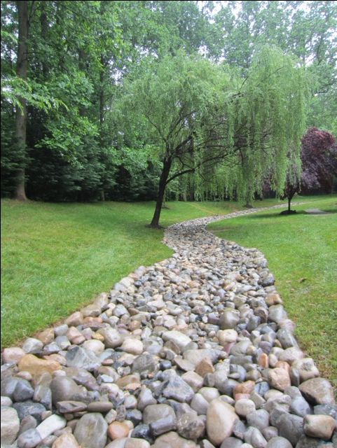 25 best ideas about drainage pipe on pinterest for Large river rock landscaping