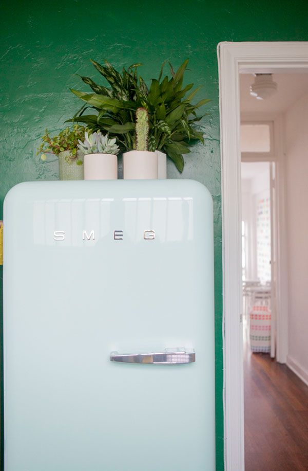Love the emerald walls with the pastel smeg! @Gin Oliveiro