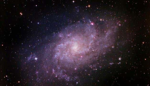 Astronomy Picture of the Day: 01/16/14 - The Triangulum Galaxy  This is the picturesque Triangulum Galaxy (also known as M33), which is located approximately 3 million light-years from Earth in the constellation of Triangulum. It stretches 50,000 light-years across and is one of the most distant objects that can be seen by the naked eye. Meaning, you would likely see it as a single star, when it's really a galaxy with billions of stars spread throughout.  M33 is the third