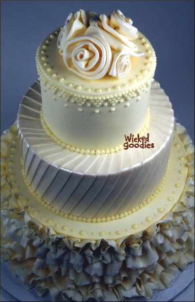 White wedding cake by Wicked Goodies