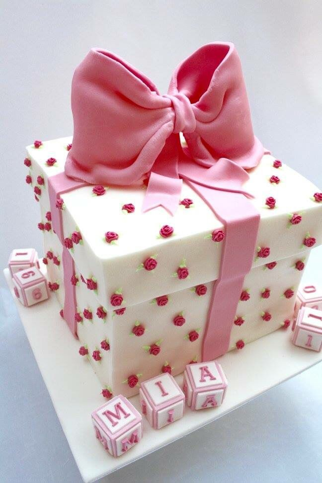 A Gift Box Cake With A Large Pink Bow For A Baby Girl S