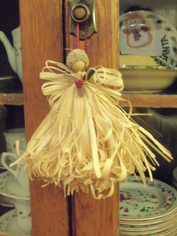 Angel made from Corn stalk/husk hanging on my pie safe.