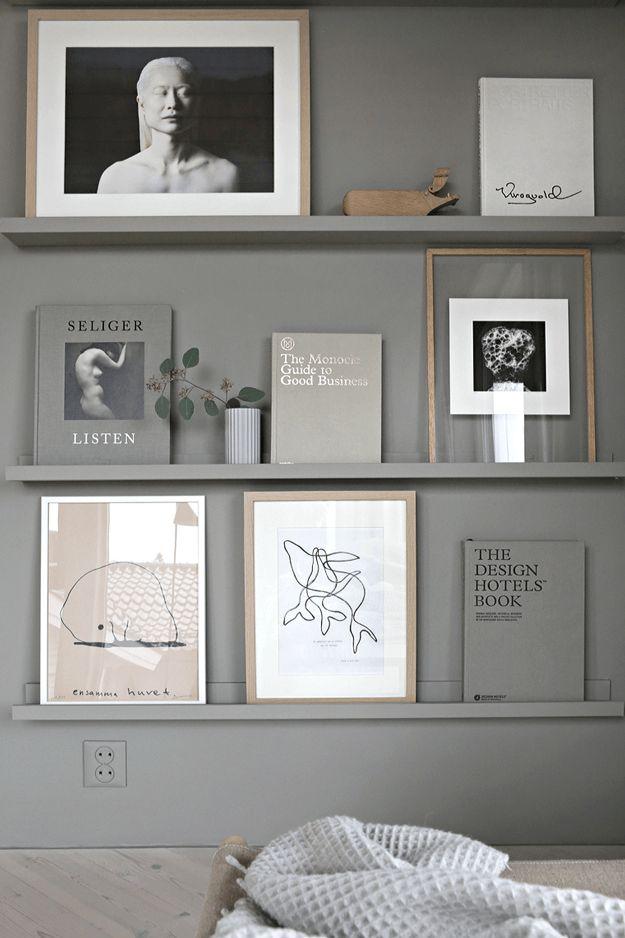 warm grey art and book wall, pantone neutral gray