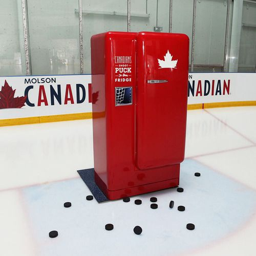 Molson Slap Shot Fridge: Participants shoot pucks at a small opening in the face of the fridge. An accurate shot initiates a 100dB air horn and the fridge door opens automatically, rewarding the best hockey snipers with Molson Canadian beer, swag, and tickets to major hockey games.