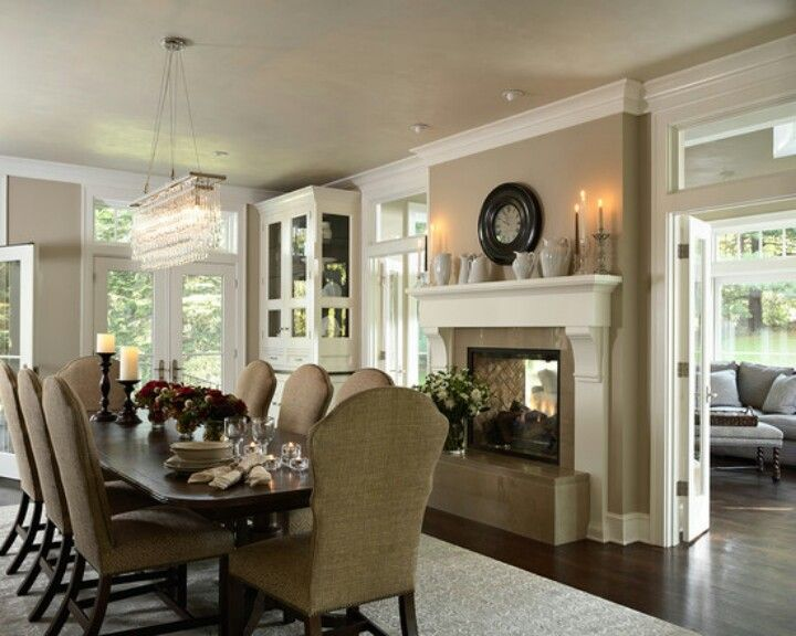 Dining Room With Renovated Two Sided Fireplace Onto The Porch Murphy Co Cabinets And Interiors By Casa Verde Design