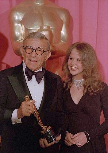 """Comedian George Burns, shown here with Linda Blair, won a best supporting actor Oscar for his work in """"The Sunshine Boys"""" (1975)."""