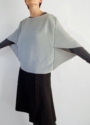 Cocoon poncho...no instructions but I think you can knit the front panel and then knit a longer rectangular panel, folder to form arm openings...stitch up at the sides and shoulders.