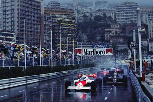 Monte Carlo, June 1984: McLaren's Alain Prost leads the Lotus of Nigel Mansell in the opening stages of the Monaco Grand Prix. Prost went on to win from a charging Ayrton Senna when the race was stopped after 31 laps due to the wet conditions. © Schlegelmilch