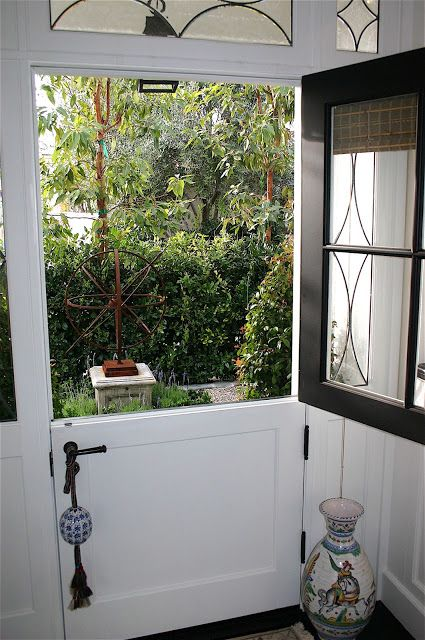 So lovely - charming dutch door....totally want one of these from kitchen into mud room