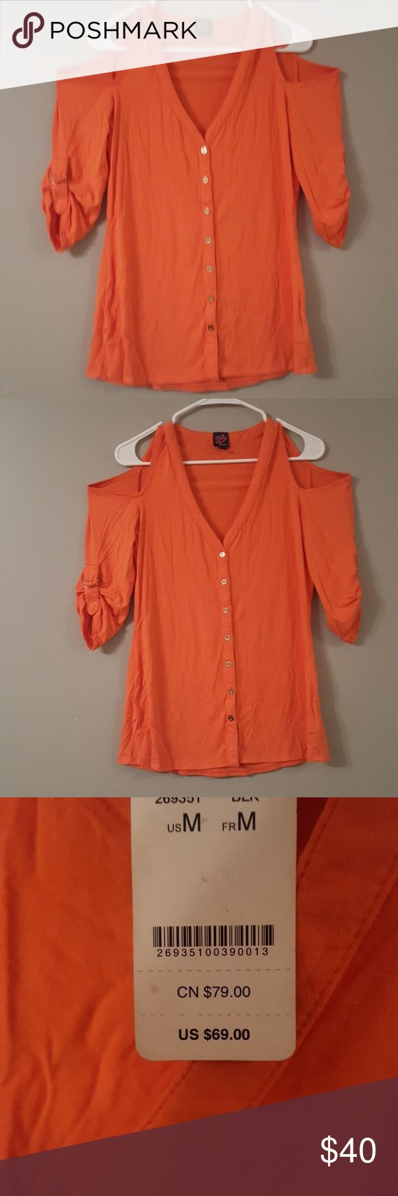 NWT 2BEBE COLD SHOULDER TOP WAS OVER $80 THIS IS A NWT 2BEBE COLD SHOULDER TOP SIZE MEDIUM A TANGERINE COLOR WITH GOLD BUTTON DOWN TOP. THE SLEEVES CAN BE LIKE THIS(UP & RUCHSED) OR DOWN FOR A DIFFERENT LOOK. I PAID OVER $80 DOLLARS BC MY NEAREST BEBE STORE IS 4 HOURS AWAY, SO I PAID FOR TAX & SHIPPING. MY PRICE IS FIRM. ❌I GIVE A 25% DISCOUNT OFF 2 OF MY LISTINGS😲. THAT'S HUGE SAVINGS!!! BUNDLE AWAY! 2bebe Tops Blouses