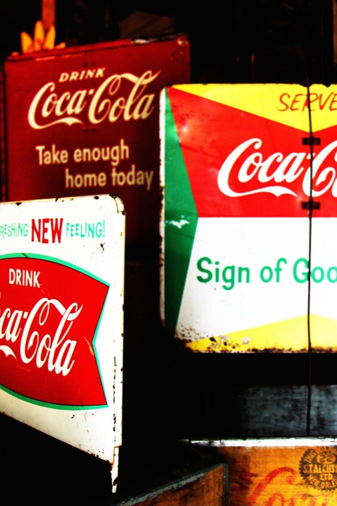 Classic Vintage Coke Signs Used In The Top Of Crates For Advertising