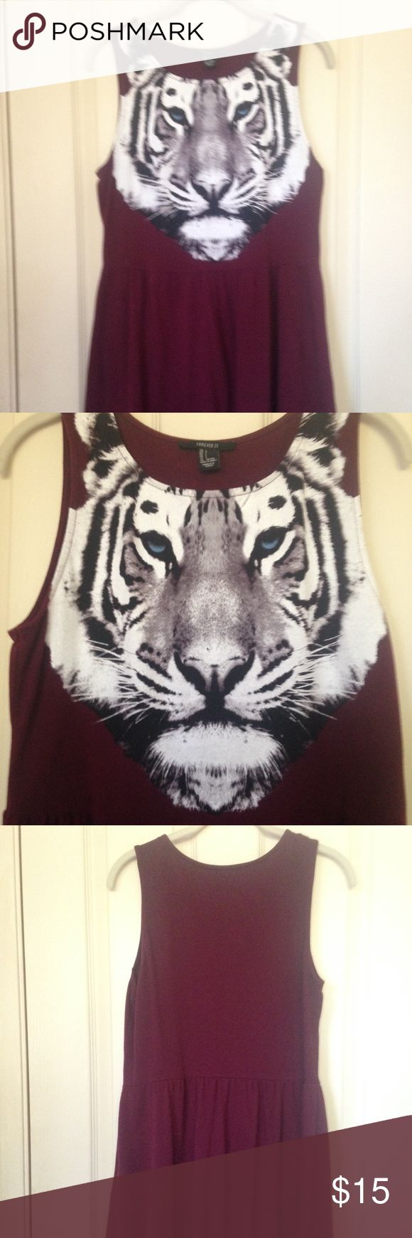 Tiger Print Dress Maroon sleeveless tiger print dress. Design on from of white tiger with blue eyes. Good condition. No tags. Size Large. Bust 17 inches, waist 16 inches and length is 32 inches. Shell 100% cotton. Forever 21 Dresses