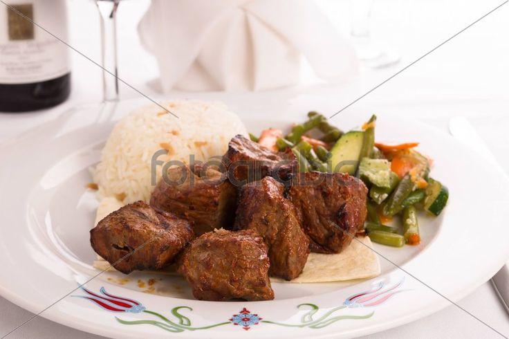 Macro Shots of Shish Kebabs and cooked Vegetables