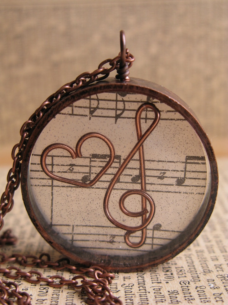 Music Lover Pendant - Copper wire heart and treble clef encased in resin with antique copper open back bezel. $10.00, via Etsy.