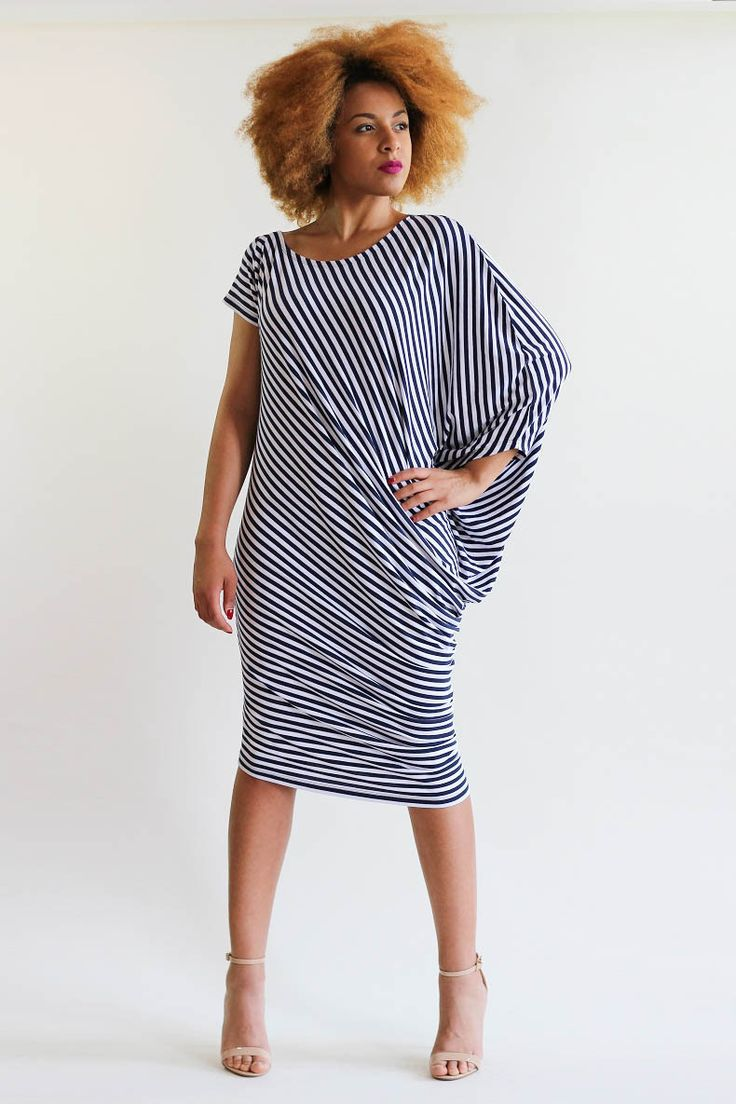 Gorgeous striped dress with one loose and one short sleeve in a gorgeous black and white stripe jersey. Made from a medium weight jersey blend . The dress has a