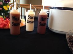 Easy way to have taco sauce and sour cream for taco bar.
