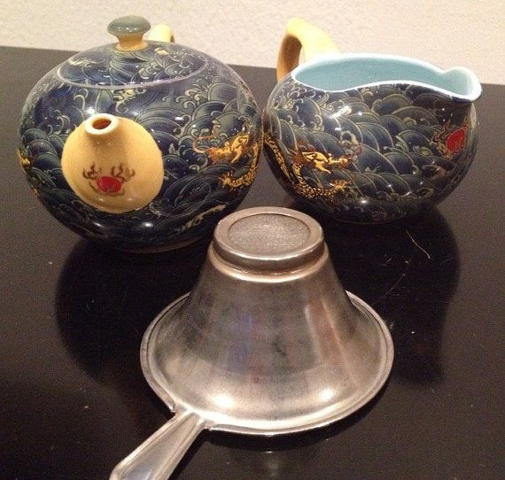 Check out this item in my Etsy shop https://www.etsy.com/listing/211282424/tea-cup-with-lid-and-milk-jug-in