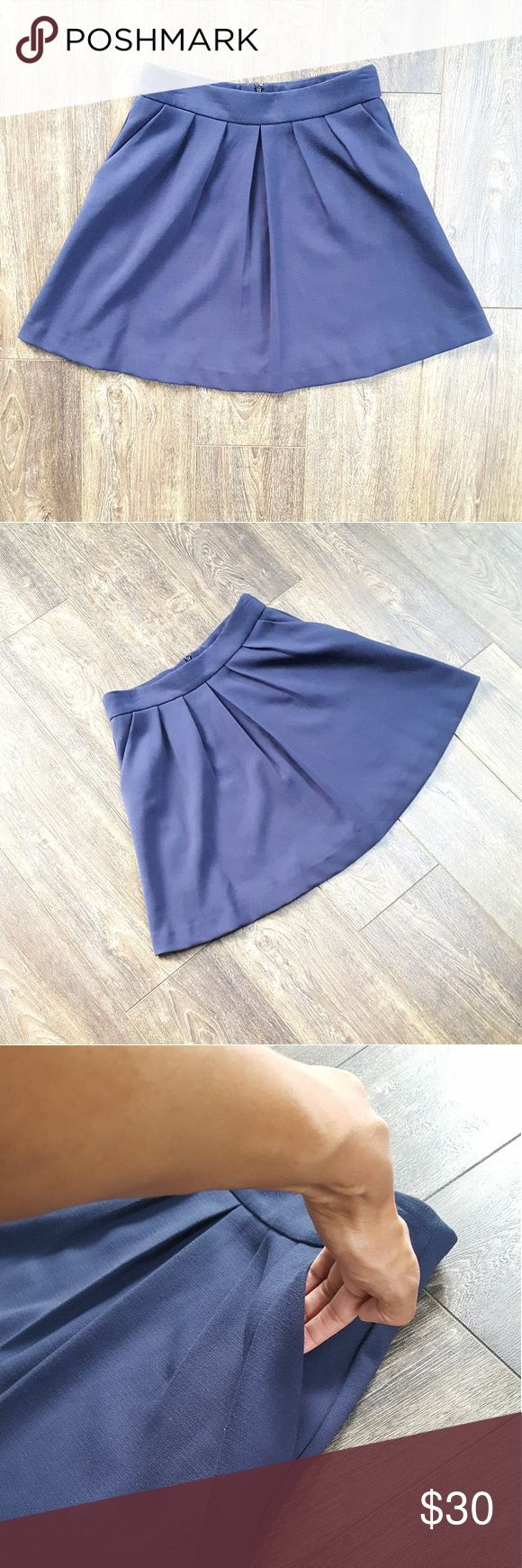 Mng by Mango Navy Skirt - Size 10 Mng by Mango Navy Skirt. Pleated folds on the front  2 front side pockets.  Hidden Zipper (back).  Excellent Pre loved condition. Mango Skirts