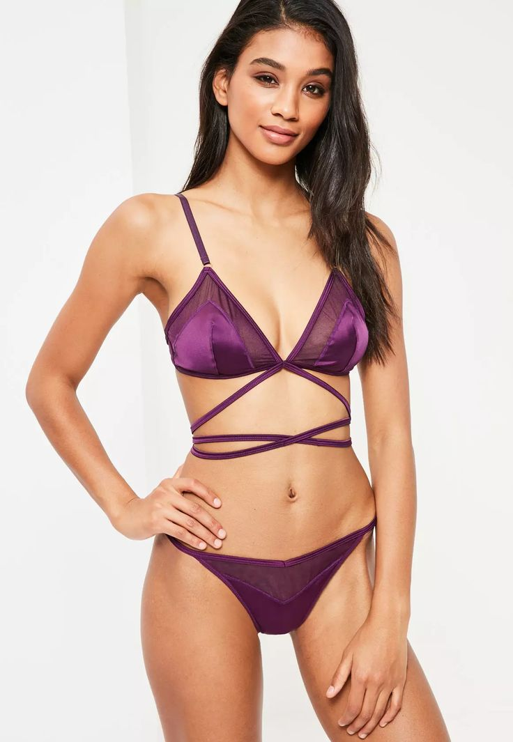 In a classic triangle design - this plum purple bra is our new guilty pleasure! In a luxe satin material with mesh inserts to each cup and lace up feature, this is perfect for when you're feelin' extra naughty!